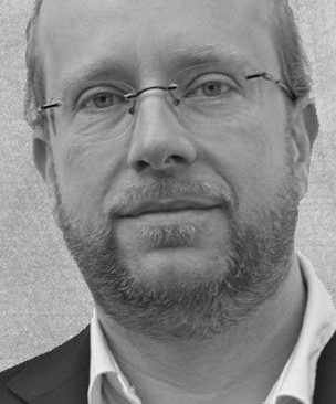 Mag. John Haas